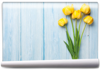 Fototapeta - Yellow tulips on wooden table