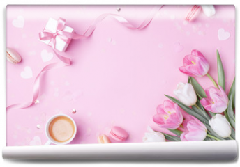 Fototapeta - Morning cup of coffee, cake macaron, gift or present box and spring tulip flowers on pink background. Beautiful breakfast for Women day, Mother day. Flat lay.