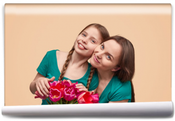 Fototapeta - Mother and daughter with flowers posing for camera