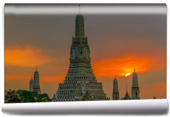 Fototapeta - Twilight wallpaper in the evening,the sun going back to the horizon,Wat Arun Ratchawaramaram is a temple along the ChaoPhraya River is an important place and a beautiful tourist destination in Bangkok