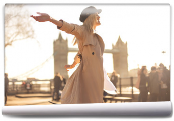 Fototapeta - Young woman walking around in the streets of London