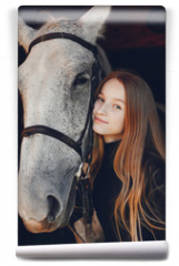 Fototapeta - Girl with a horse. Woman in a ranch. Blonde in a black sweater