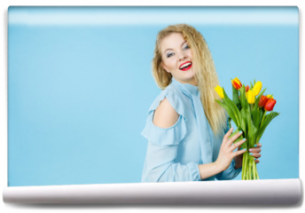 Fototapeta - Pretty woman with red yellow tulips bunch