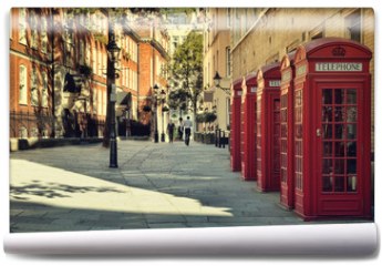 Fototapeta - Street with traditional red Phone Boxes, London.