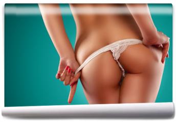 Fototapeta - Sensual Woman Stripping Off Her Lingerie