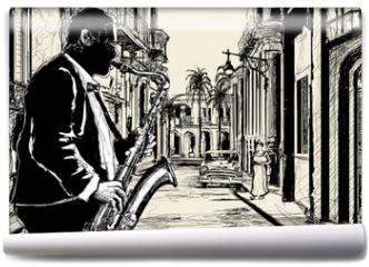 Fototapeta - saxophonist in a street of Cuba