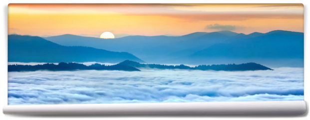 Fototapeta - Sunrise over the sea of fog in the mountains at the summer