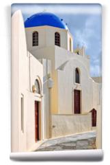 Fototapeta - Classic greek island blue dome church in narrow street, Oia