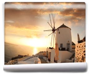 Fototapeta - Windmill in Santorini against sunset, Greece