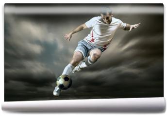 Fototapeta - Football player with ball on field of stadium