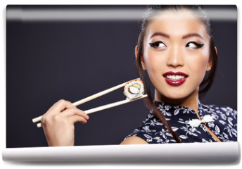 Fototapeta - Young beautiful asian woman eating sushi,