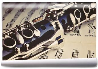 Fototapeta - Klarinette auf einem Notenblatt