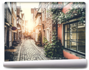 Fototapeta - Historic street in Europe at sunset with retro vintage effect