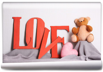 Fototapeta - Decorative letters forming word LOVE with teddy bear