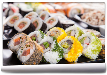 Fototapeta - Delicious sushi pieces served on black stone
