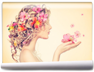 Fototapeta - Beauty girl takes beautiful flowers in her hands