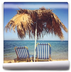 Fototapeta - Sunbeds with umbrella on the beach