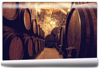 Fototapeta -  Wooden barrels with wine in a wine vault, Italy