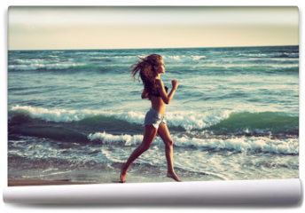 Fototapeta - active on beach