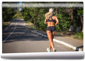 Fototapeta - young woman jogging in the park in summer