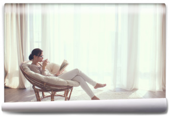 Fototapeta - Woman relaxing in chair