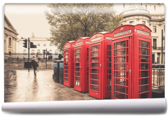 Fototapeta - Vintage style  red telephone booths on rainy street in London