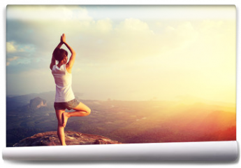 Fototapeta - yoga woman meditation on mountain peak
