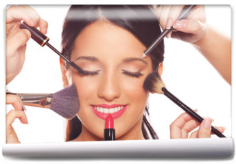 Fototapeta - Young woman getting professional beauty and makeup treatment