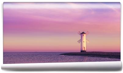 Fototapeta - Purple sunrise over Baltic Sea coast.