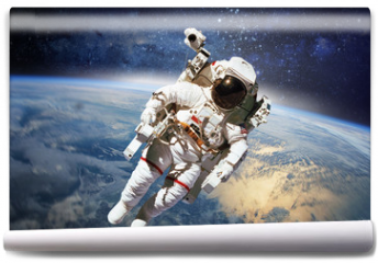 Fototapeta - Astronaut in outer space with planet earth as backdrop. Elements