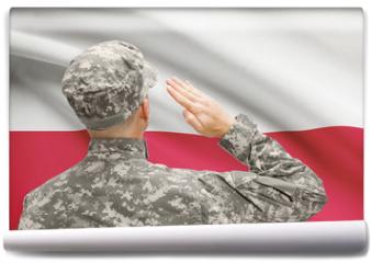 Fototapeta - Soldier in hat facing national flag series - Poland