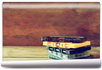 Fototapeta - close up photo of stack of Cassette tapes over wooden table