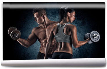 Fototapeta - Athletic man and woman with a dumbells.