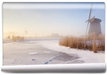 Fototapeta - Dutch windmills in a foggy winter landscape in the morning