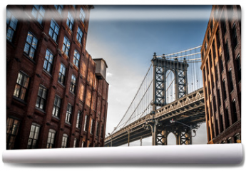 Fototapeta - Manhattan bridge seen from a narrow alley enclosed by two brick buildings on a sunny day in summer
