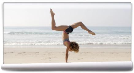 Fototapeta - Woman Practicing Yoga Outdoors