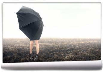 Fototapeta - Dziewczyna z parasolką na polu