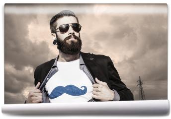 Fototapeta - Młody hipster, superbohater pod ciemnym niebem.