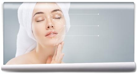 Fototapeta - applying cosmetic cream