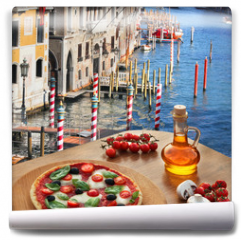 Fototapeta - Classic Italian pizza in Venice against canal, Italy