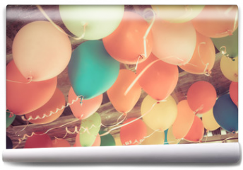 Fototapeta - Colorful balloons floating on the ceiling of a party in vintage