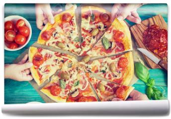 Fototapeta - Family takes pieces of pizza