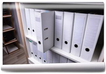 Fototapeta - Folder Coming Out From Shelf