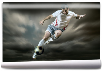 Fototapeta - Football player with ball on field of stadium