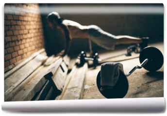 Fototapeta - Guy pressed to the floor in the gym on the roof