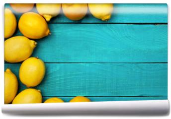 Fototapeta - Lemons on the bright cyan background
