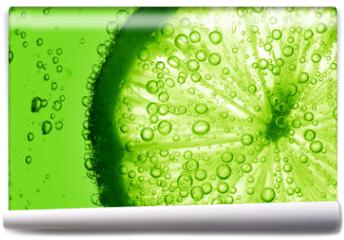 Fototapeta - lime slice in water