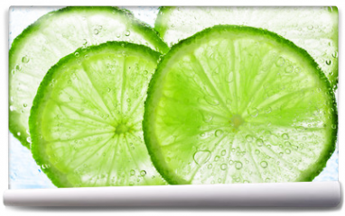 Fototapeta - lime with bubbles isolated on white