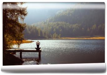 Fototapeta - meditation and yoga practicing at sunset
