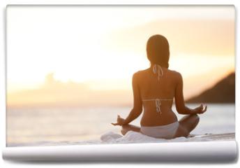 Fototapeta - Meditation - Yoga woman meditating at beach sunset